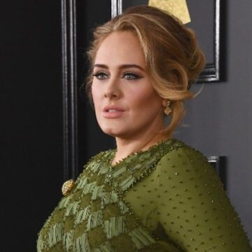 Fans accuse Adele of cultural appropriation after Jamaican flag bikini and Bantu knots pic