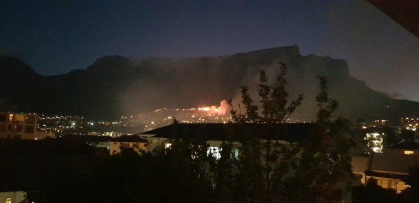 Table Mountain fire: Firefighters battle raging blaze fanned by strong wind