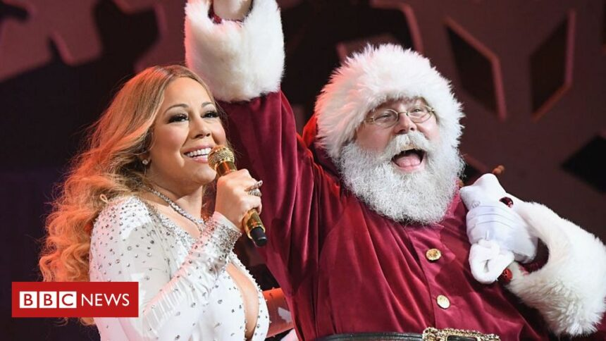 Mariah Carey's All I Want For Christmas tops the UK charts after 26 years