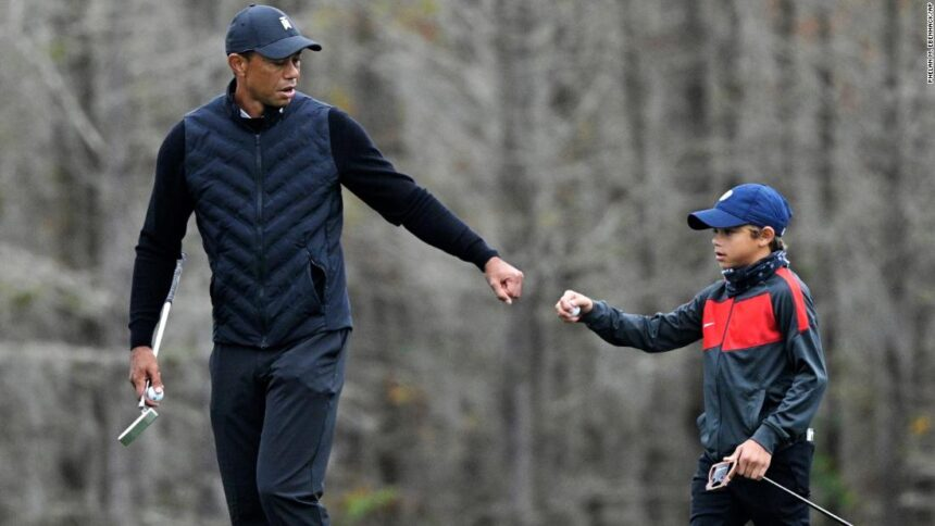 Tiger Woods warms up with his son Charlie, 11, and the similarities are striking