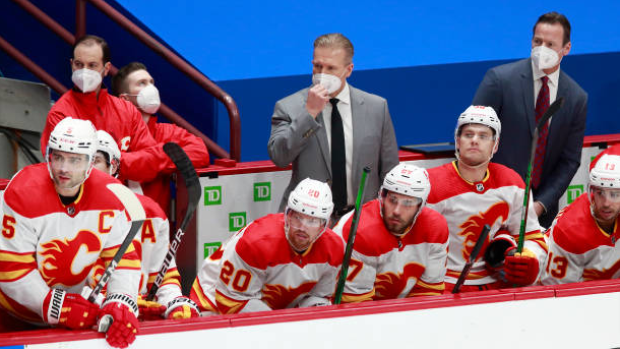 Flames fire Ward; hire Sutter as coach for second stint