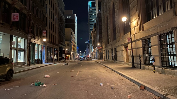 Rioters set fires, smash windows in Old Montreal curfew protest