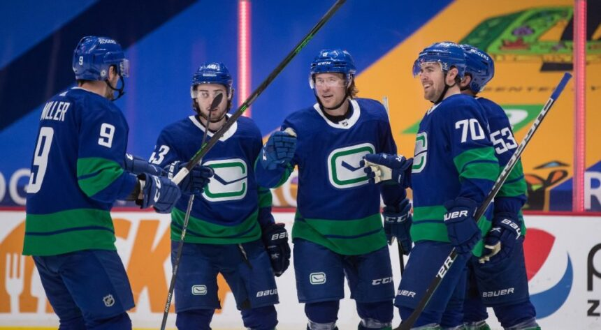 Holtby solid as Canucks snap Senators' three-game win streak